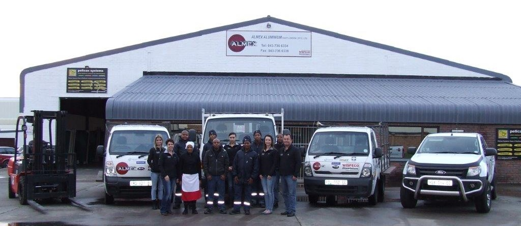 The Almex Team in front of their building